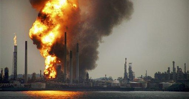 Explosions rock Shell's Singapore refinery