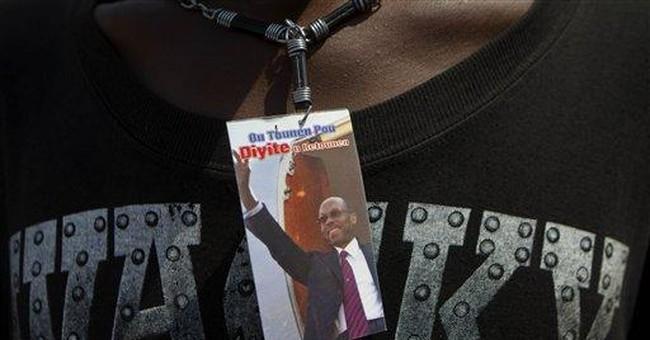 Aristide supporters in Haiti mark coup anniversary
