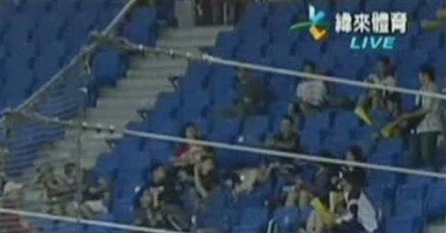 Taiwan fan drops toddler, bungles foul ball catch