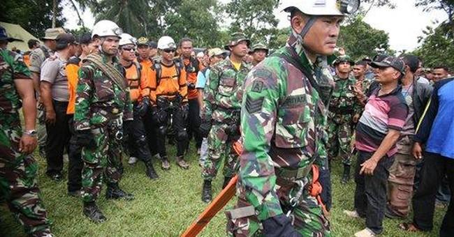 Rescuers find 18 bodies in Indonesia plane crash
