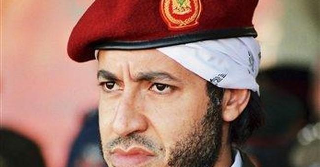 Gadhafi son denies Interpol allegations