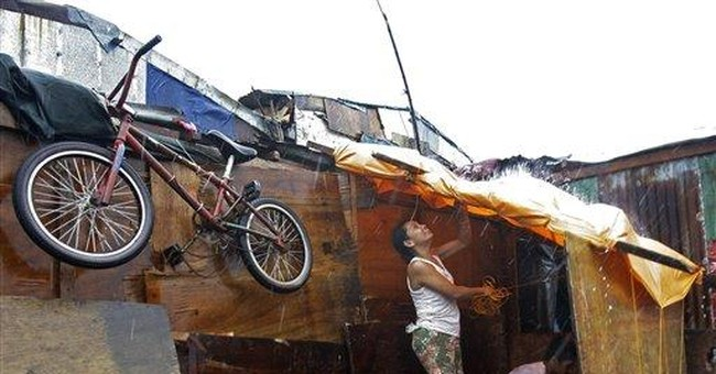 Filipinos still trapped on roofs; typhoons kill 59
