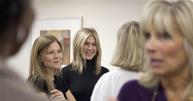 Jennifer Aniston tours breast cancer center