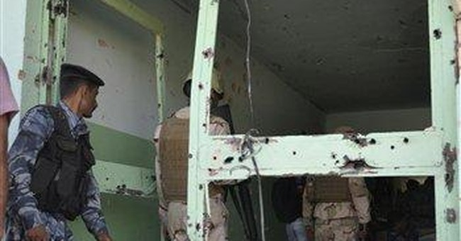 Gunmen kill 4 in hostage standoff in western Iraq