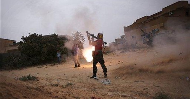 Fleeing Gadhafi bastion, bitter at the new Libya