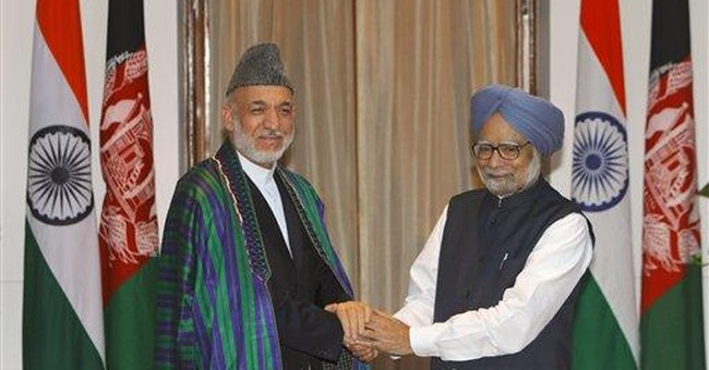 Afghanistan signs pact with India, irking Pakistan
