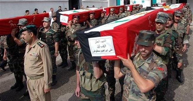 Syrian troops, army defectors clash; 4 killed