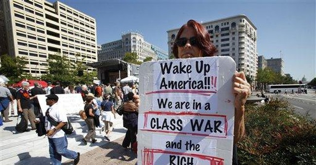 Protesters against war and corp. greed rally in DC