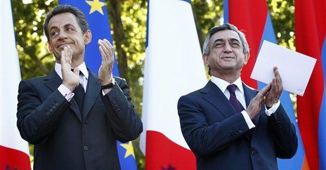France urges Turkey to recognize Armenian genocide