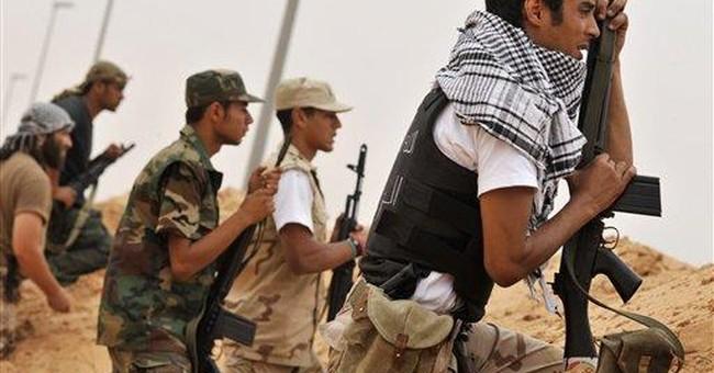 Libyans claim gains in Gadhafi hometown offensive