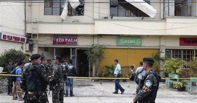 2 blasts wound at least 11 in southern Philippines