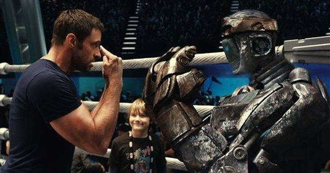 Robots take title as 'Real Steel' earns $27.3M
