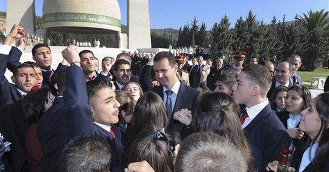 AP Interview: Syrian activist's son urges protest