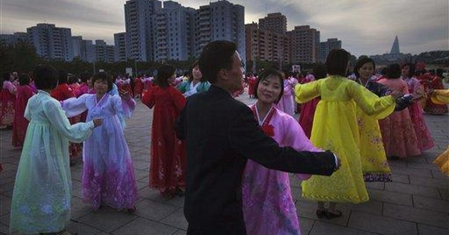NKorea notches up cult around 'Illustrious' son
