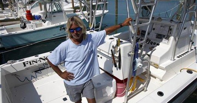 7 survive 20 hours at sea clinging to boat, cooler