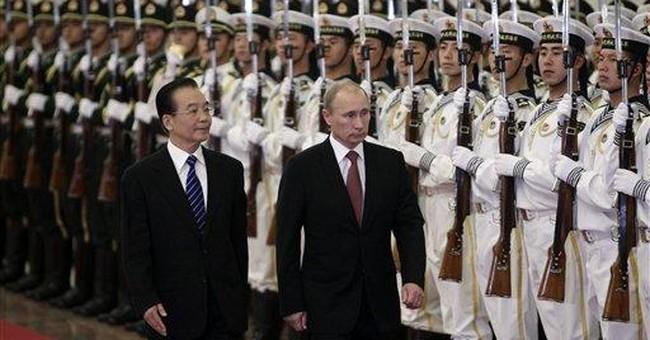 Russian PM Putin in China seeking closer ties