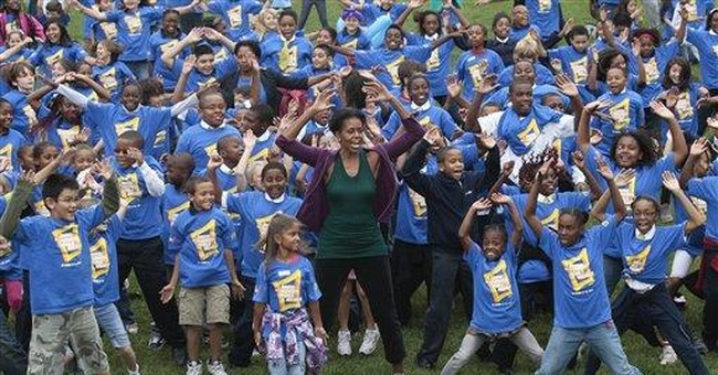 Michelle Obama takes aim at jumping jacks record