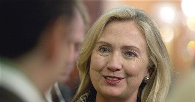 AP Interview: Clinton tries to ward off Hill cuts