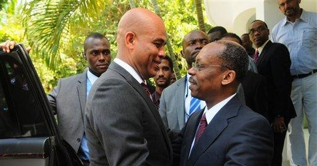 Haiti's president meets with 'Baby Doc,' Aristide