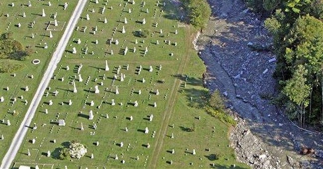 Flooded Vt. town struggles to ID cemetery remains