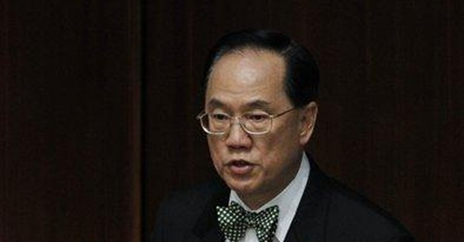 HK revives housing scheme amid property cost anger
