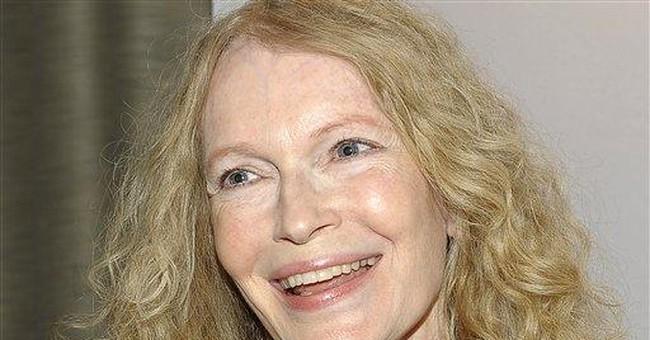 Actress Mia Farrow gives Darfur items to UConn