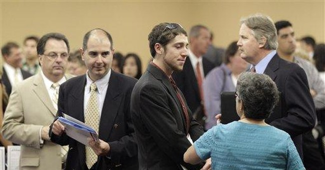 Applications for unemployment aid barely changed