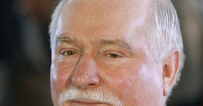 AP Interview: Walesa backs Wall Street protesters