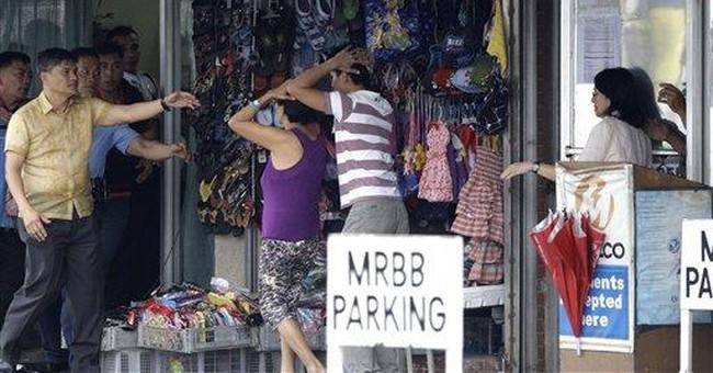 Gunmen release Philippine bank hostages, surrender