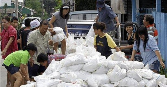 Bangkok rushes to dig canals to prevent flooding