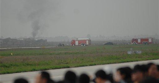 Chinese pilot dies as jet nose-dives at air show