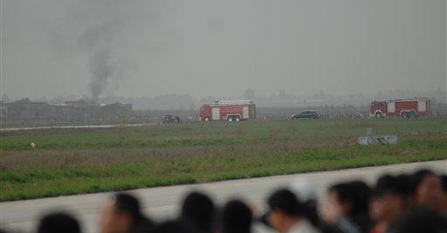 Chinese fighter jet nose-dives into field at show