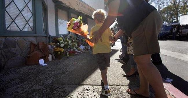 Victims' relatives shout at salon shooting suspect