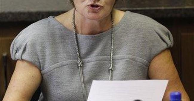 Family of slain Belfast lawyer condemns UK premier