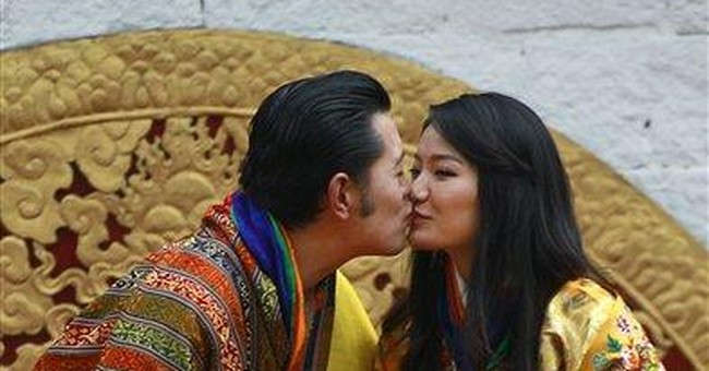 Bhutan king and queen share first public kiss