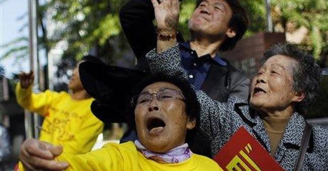 Japan's leader to return looted royal Korean books