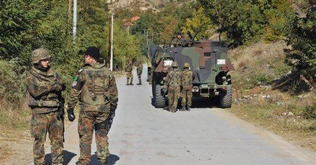 Kosovo Serbs refuse to lift roadblocks