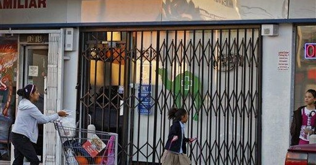 Fed threat gets results as Calif pot shops close