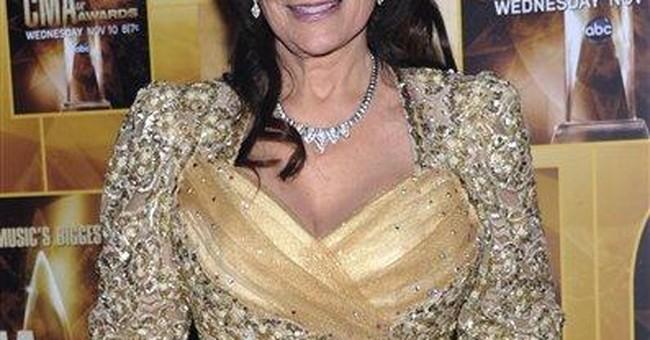 Singer Loretta Lynn hospitalized with pneumonia