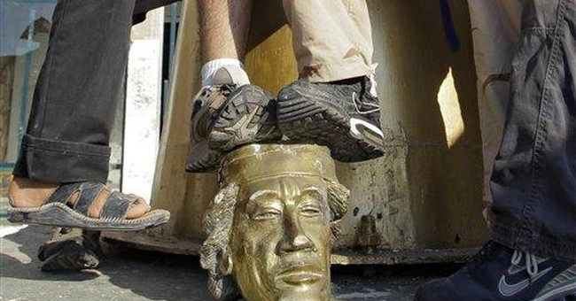 Hardened Misrata fighters vented fury on Gadhafi