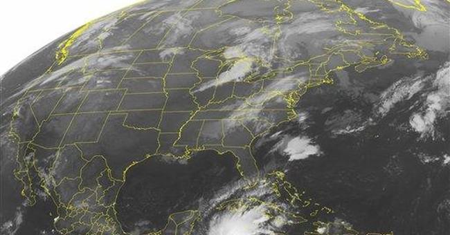 Rina becomes hurricane off Honduras, boat missing