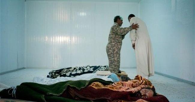 Gadhafi buried in secret site in Libyan desert