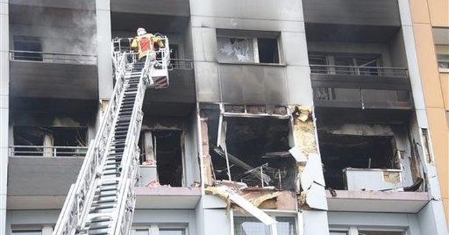 Swiss police: 1 dead, 14 injured in building blast