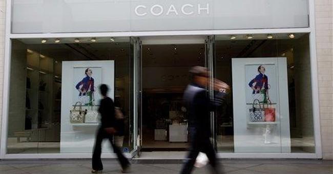 Coach fiscal 1st-quarter profit rises 14 pct