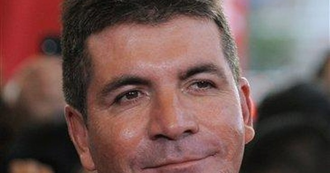 Cowell talks voting by social media on 'X Factor'