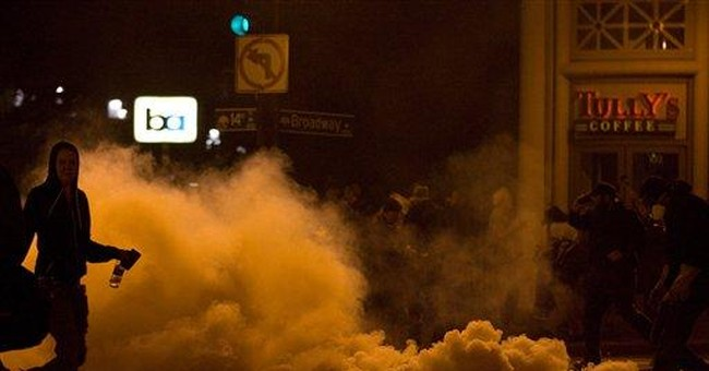 Riot squads clear Wall St. protests in 2 cities