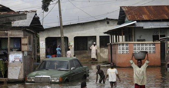 As Nigeria floods rise, canoes and cholera return