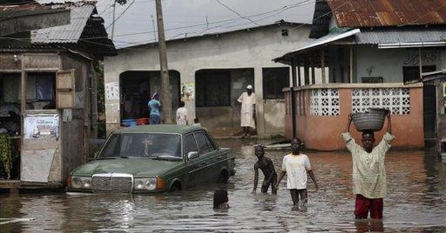 As Nigeria floods rise, canoes and cholera return