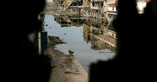 Gadhafi hometown pays heavy price in Libyan battle