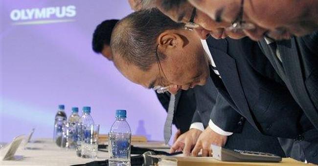 Olympus denies wrongdoing as groups urge reforms